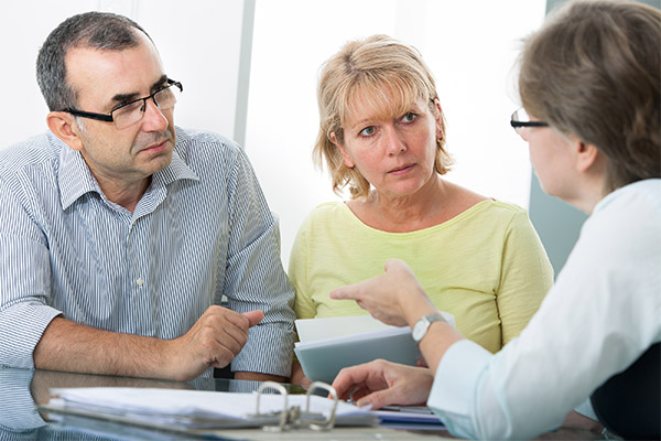financial advisor with couple